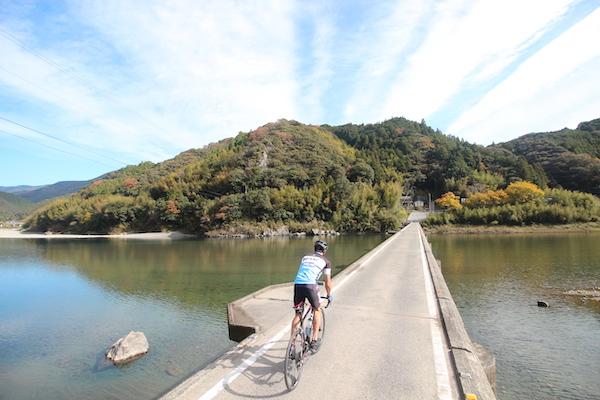 cyclist riding across bridge during great earth kochi