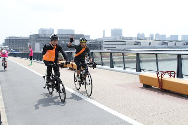 cyclist waving during the Bicycle Ride in Tokyo