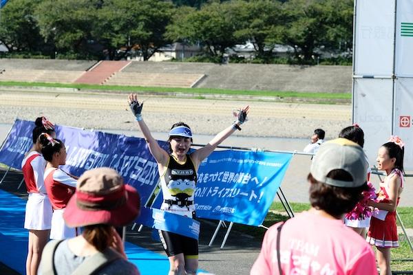 Woman finishing triathlon in Japan