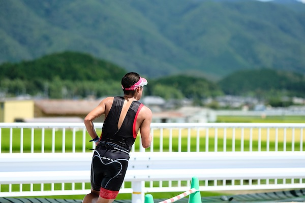 Male participating in triathlon in Japan