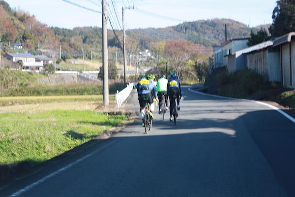 cyclist cycling on road in izu