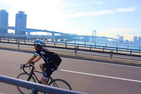 cyclist on a bridge in tokyo