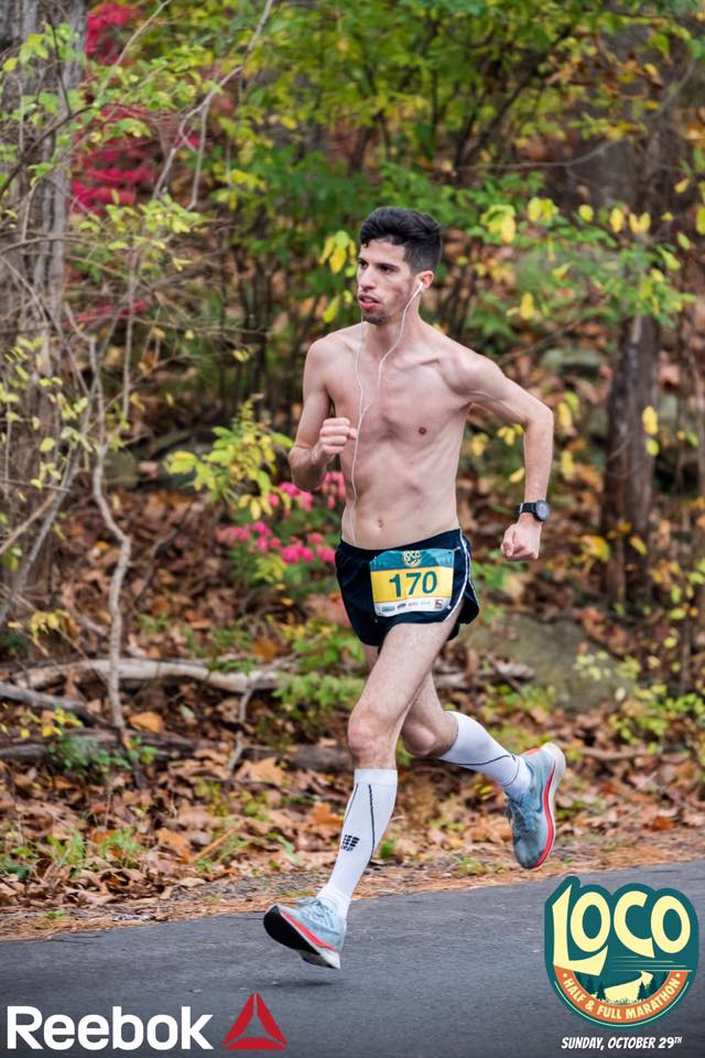 Shirtless man running