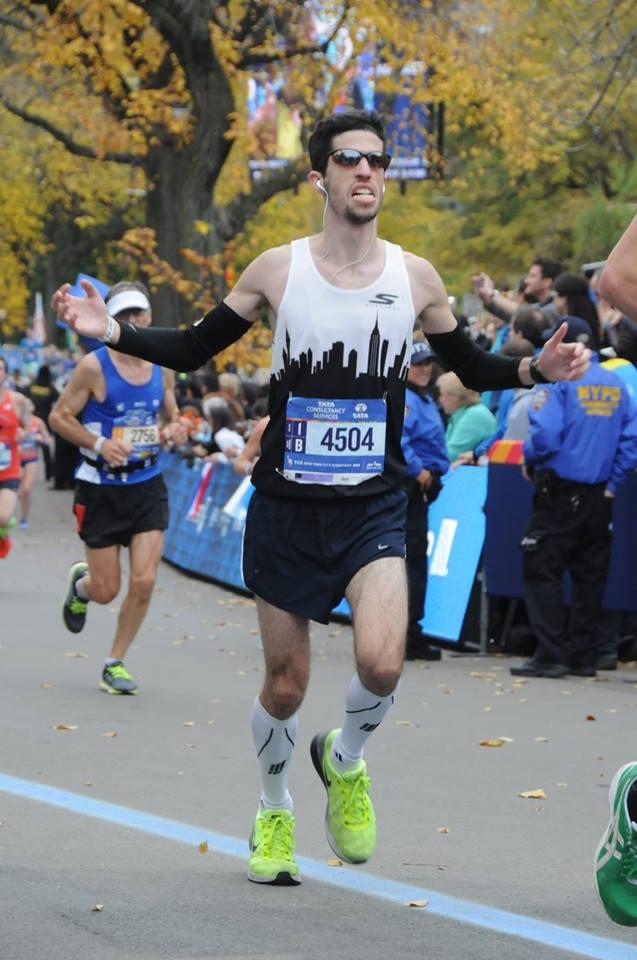 Man running on road at race