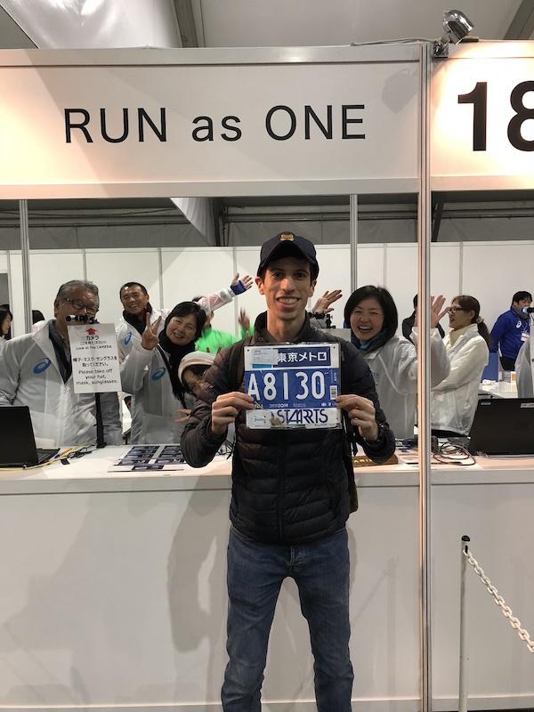 Dan holding his Tokyo Marathon bib