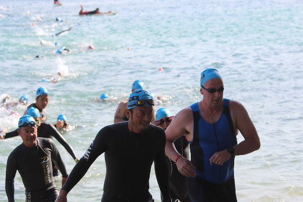 swimmers finishing swim course at Okinawa International triathlon