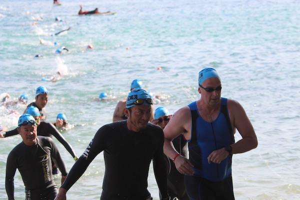 swimmers finishing swim course at Okinawa International triathlon