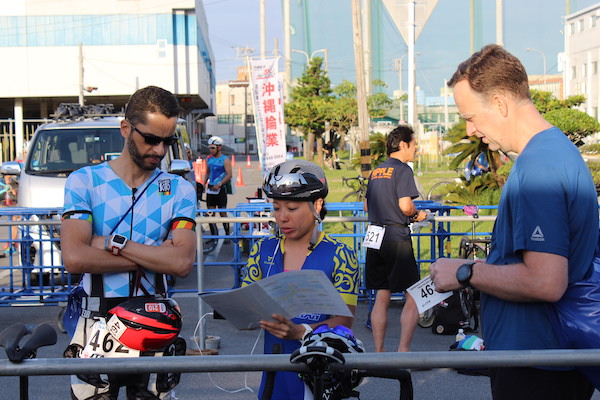 faith helping samurai sports registrants before Okinawa International Triathlon