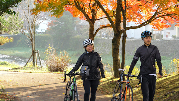 cyclist walking bikes during tour of western Japan