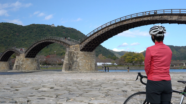 cyclist looking at a bridge