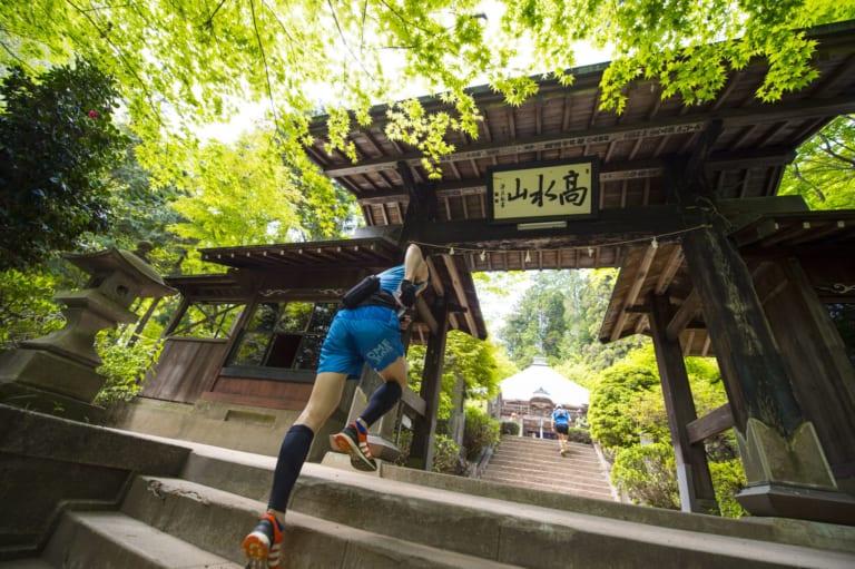 runner during nariki forest trail race