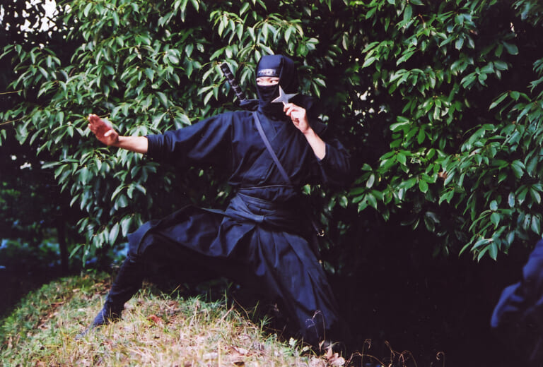 Photo of a single ninja in black garb